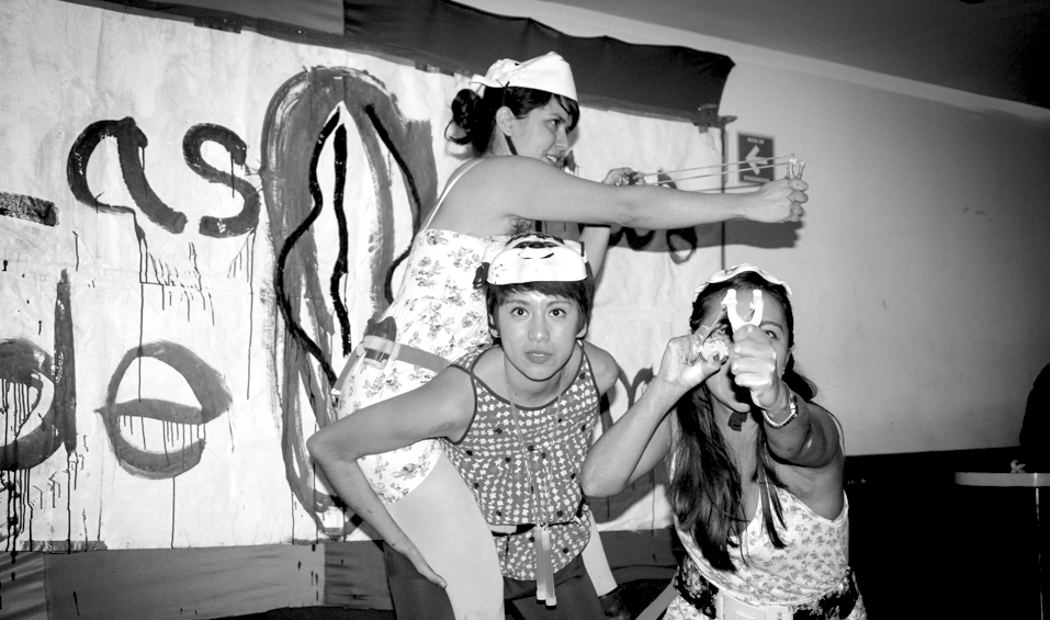The Hijas de Violencia fight street harassment with the aid of feminine dresses and toy weapons. Photo: Caitlin Donohue/Nark Magazine